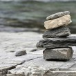 Stock Photo: Pebble stack on rock