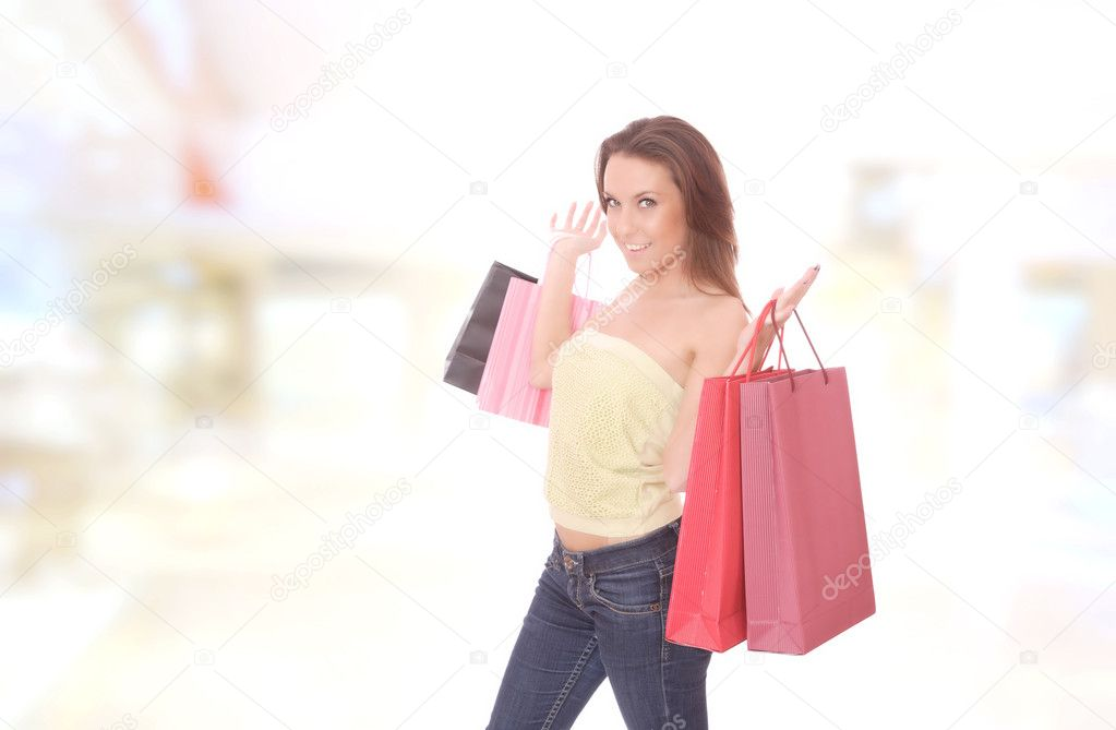 Shopping young woman smiling in the shopping mall. — Stock Photo #2345491