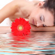 Woman with flower getting spa treatment — Stock Photo