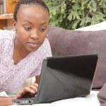 Beautiful young woman using laptop — Stock Photo #2354305