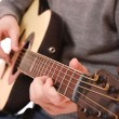 Guitarist hand playing guitar - 