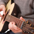 Guitarist hand playing guitar - Photo