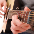 Guitarist hand playing guitar - Foto Stock