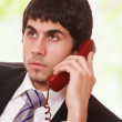 Young businessman working with phone — Stock Photo #2355988