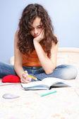 Beautiful teenager studying — Stock Photo