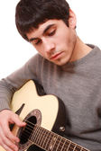Guitarist hand playing guitar — Stock Photo
