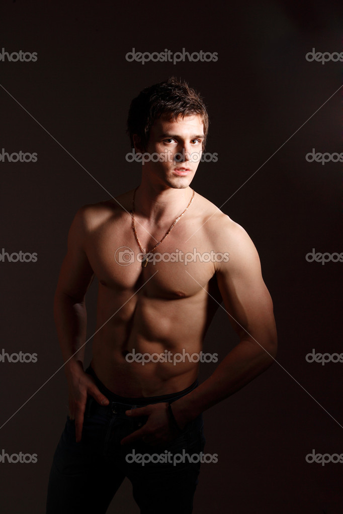 Studio portrait of handsome man showing his muscles  Lizenzfreies Foto #2352910