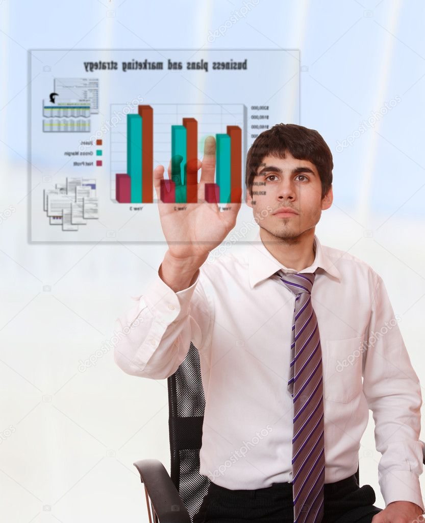 Young businessman studying a business plan on a virtual screen  Stock Photo #2355445
