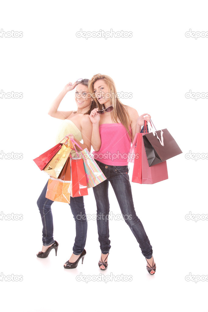 Two happy young beautiful women with the purchases - on white — Stock Photo #2358207