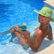 Woman enjoying a swimming pool - Stock Photo