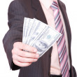 Businessman holds money in a hand — Stock Photo