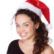 Young woman wearing christmas hat — Stockfoto