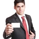 Businessman presenting card — Stock Photo #2676901