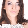 Attractive woman takes lot of 100 dollar bills — Stock Photo #2678307