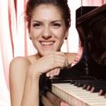 Woman playing piano — Stock Photo #2693983