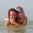 Happy brother and sister embrace each other in the water — Stock Photo #2380806