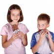 Young children eating chocolate — Stock Photo