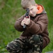 Child with gun — Stock Photo #2385473
