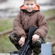 Child with gun - Stock Photo