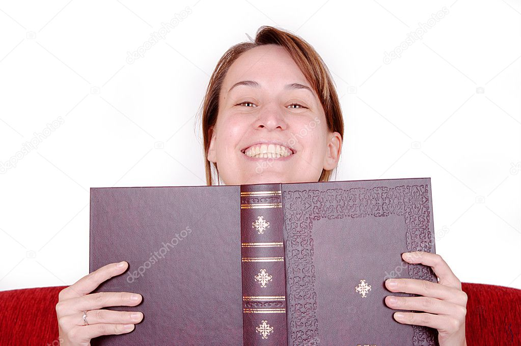 Young woman hiding behind the book, staring at you — Stock Photo #2380414