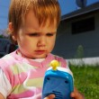 Young child with toy phone — Stock Photo #2390213