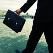 Stock Photo: Business men steps into the river