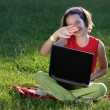 Stock Photo: Young girl with laptop outdoor