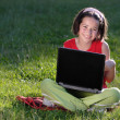 Young girl with laptop outdoor — Stock Photo