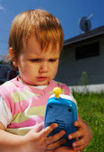 Young child with toy phone — Stock Photo