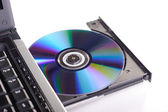 DVD ROM on a laptop — Stock Photo