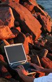 Laptop among rocks — Stock Photo