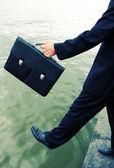 Business men step into the river — Stock Photo