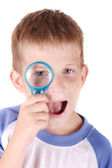 Child with loupe — Stock Photo