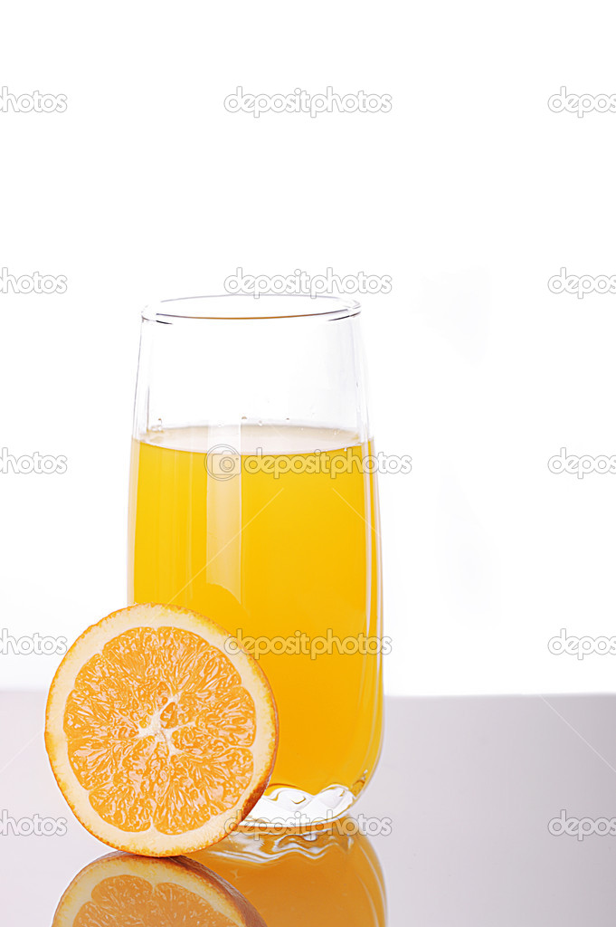 Fresh orange juice in a glass with a half orange   Stock Photo #2496486