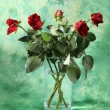 Stock Photo: Red roses in vase