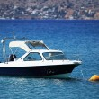 Stock Photo: Small motorboat on sea