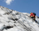 Ascending mountaineer — Stock Photo