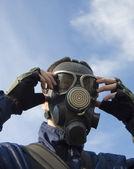 Man wearing gas-mask — Stock Photo