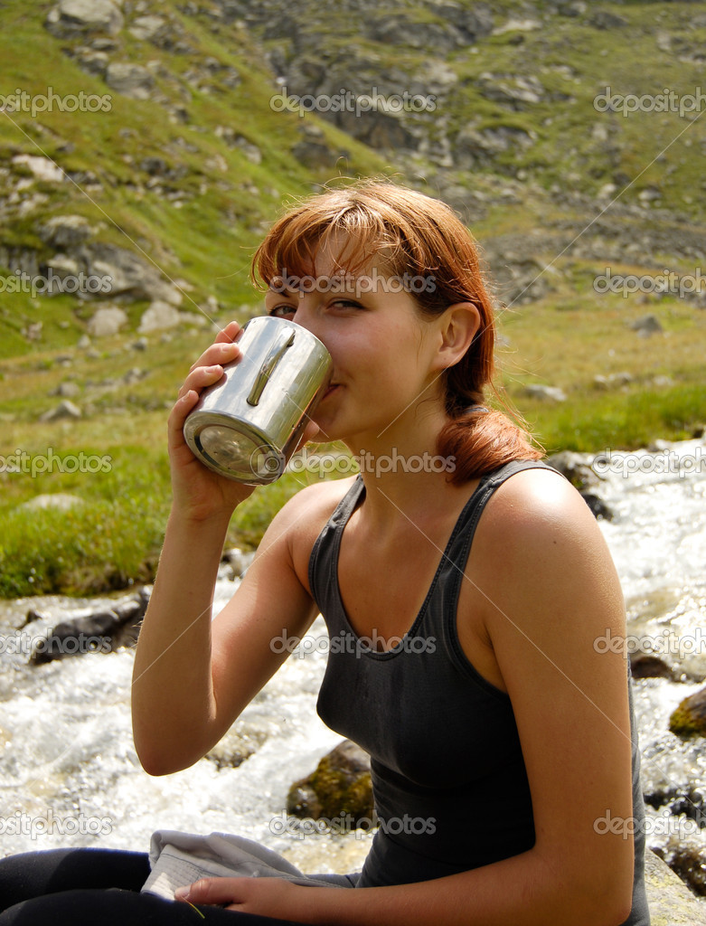 Red haired girl drinking water — Stock Photo #2338846
