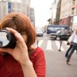 Girl with a camera — Stock Photo