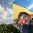 Young man with umbrella — Stock Photo