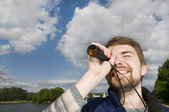 Looking at a spyglass — Stock Photo