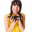 Girl wearing yellow dress with a gift box — Stock Photo