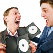 Two cheerful businessmen with blank DVDs — Stock Photo