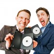 Stock Photo: Two businessmen holding DVDs