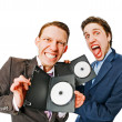 Two businessmen holding DVDs - Stock Photo