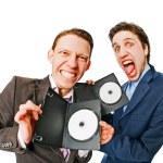 due uomini d'affari tenendo DVD — Foto Stock