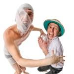 Mummy chasing archeologist — Stock Photo