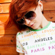 Stock Photo: Red-haired girl in sunglasses