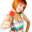 Beautiful red girl with candy — Stock Photo #2354370